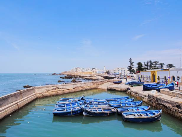 The walled city of Essaouira sitting on the edge of the water
