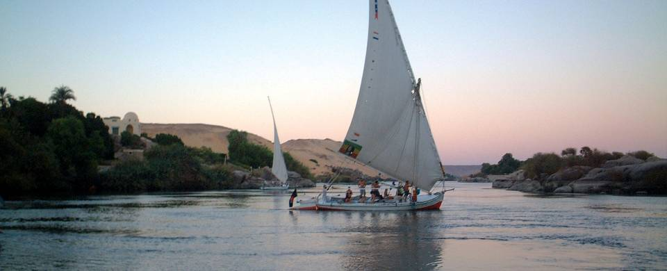 A felucca sailboat gliding across the water