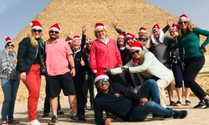 Festive King Ramses - tour group with santa hats