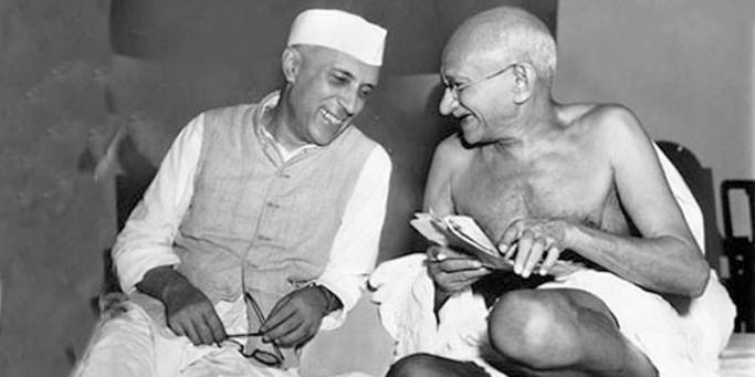 A photo of Gandhi chatting with Nehru