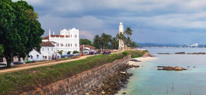 Panoramic view of the white lighthouse in Galle fort, Sri Lanka where we offer day tours and guided