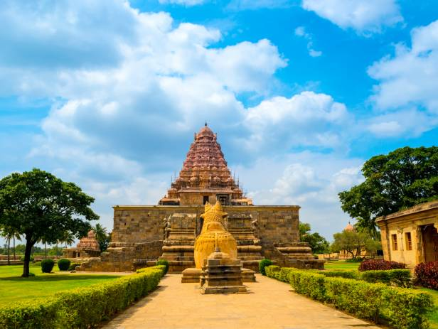 Brahadishwara Temple in Tanjore against a dazzling blue sky with wisps of cloud