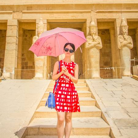 Girl in front of Queen Hatshepsut Temple - Egypt Tours - On The Go Tours