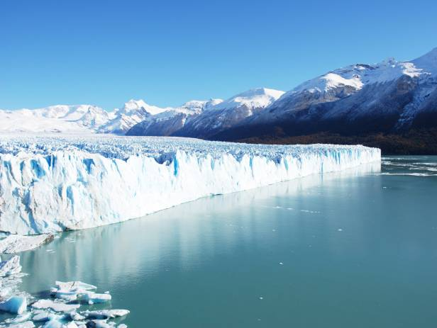 Impressive Perito Moreno glacier surrounded by snowy mountains in El Calafate