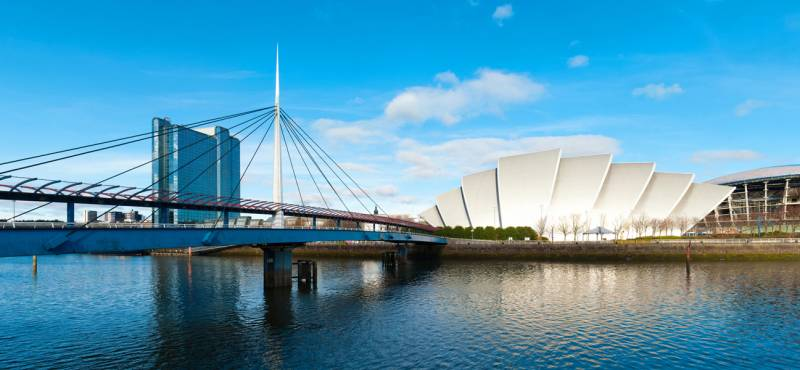 A panorama photo of the Glasgow's Bell's Bridge crossing the river Clyde in Scotland