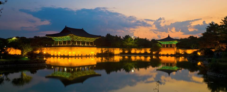 Pagodas lit up at night on the Anapji Pond in Gyeongju