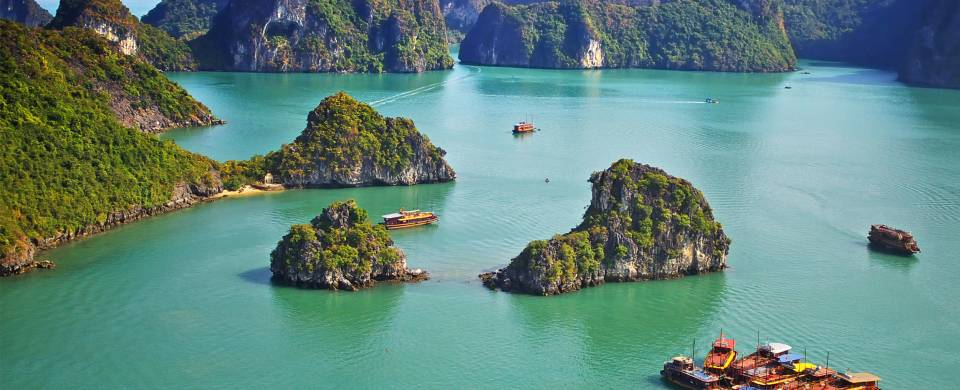 The jade coloured waters of Halong Bay studded with karst islands