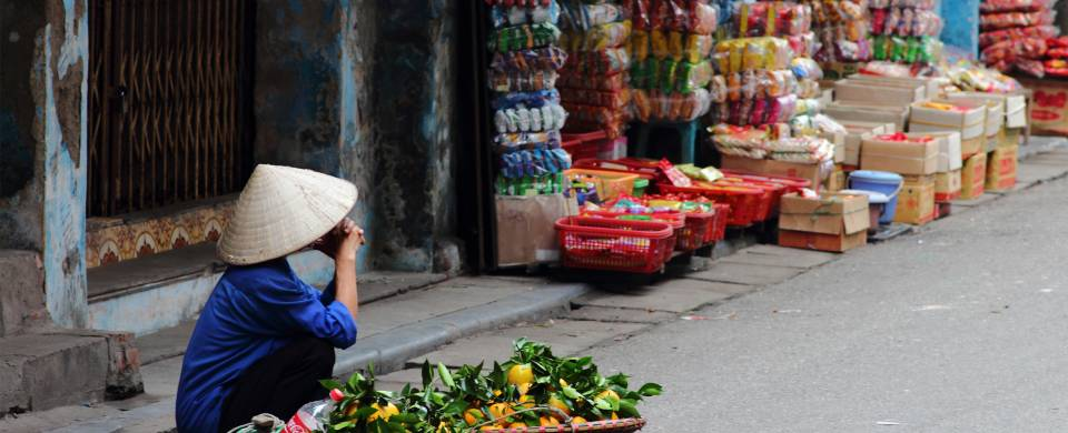 Hawker selling wares on the streets of Hanoi