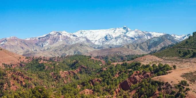 Admire the stunning High Atlas mountain range on your journey towards Ouarzazate | Morocco