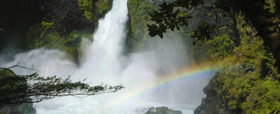 Tumbling waterfall and rainbow in Huilo Huilo
