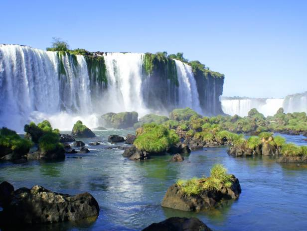 The majestic Iguazu falls creating white mist as they topple down
