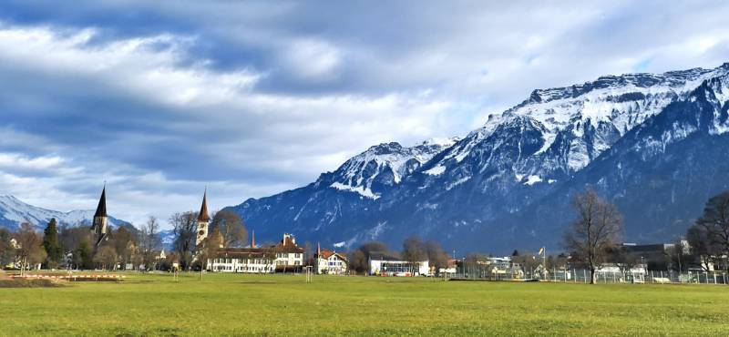 A panoramic view of Interlaken with snowcapped mountains in the background
