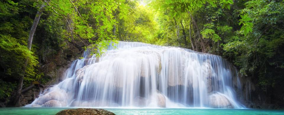 Picturesque waterfall in the middle of the jungle in Kanchanaburi