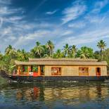 On the backwaters of Kerala in a traditional riceboat