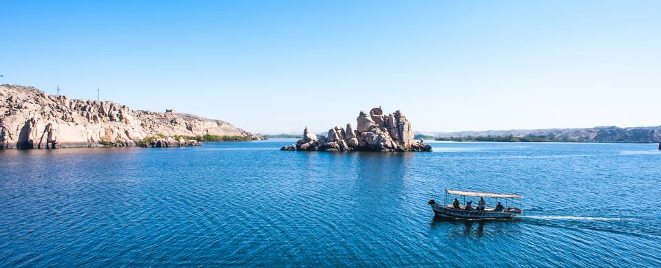 A boat on the sparkling blue water of Lake Nasser