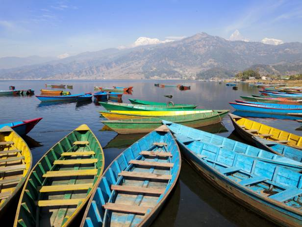 Colourful boats on the edge of the lake in Pokhara