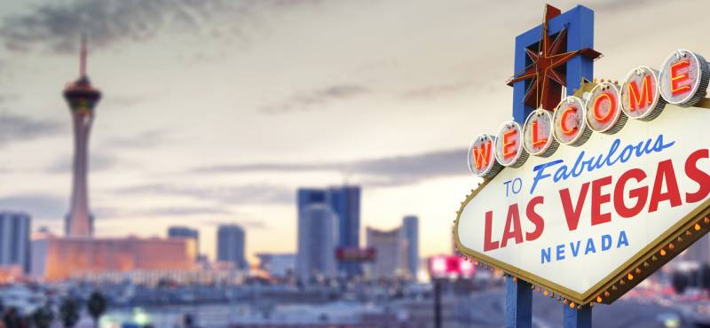 The 'welcome to Las Vegas' sign against a panoramic view of the city skyline