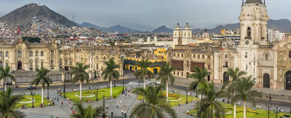 View across the Plaza Mayor in Lima with mountains in the background