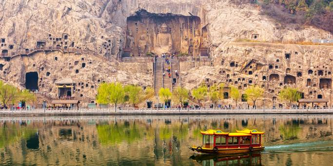 Longman Grotto by boat in Louyang | China