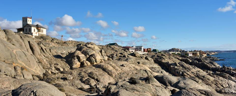 House sat upon rocks stretching out in to the sea at Luderitz
