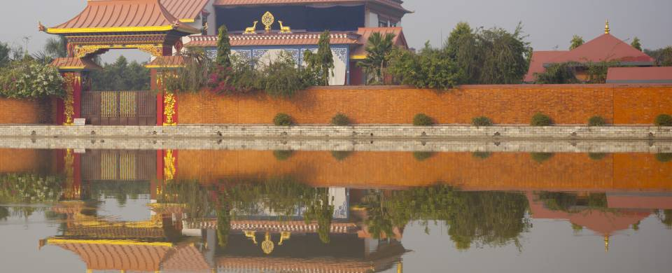 Reflection of a temple on the water in Lumbini