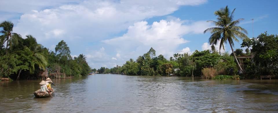 Boat rowing its way along the Mekong Delta