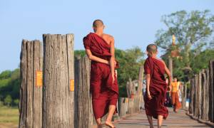 Monks on Bridge in Myanmar - Southeast Asia - On The Go Tours