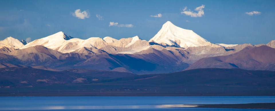 The snowcapped mountains that back the crystal waters of Namtso Lake in Tibet