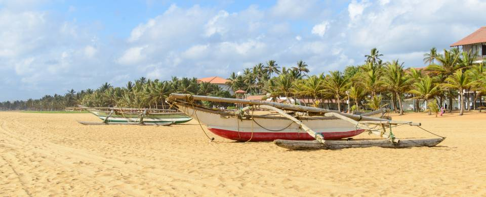 Traditional Sri Lankan fishing boat on the sandy beach in Negombo