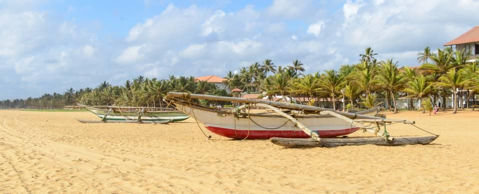 Traditional Sri Lankan fishing boat on the sandy beach in Negombo