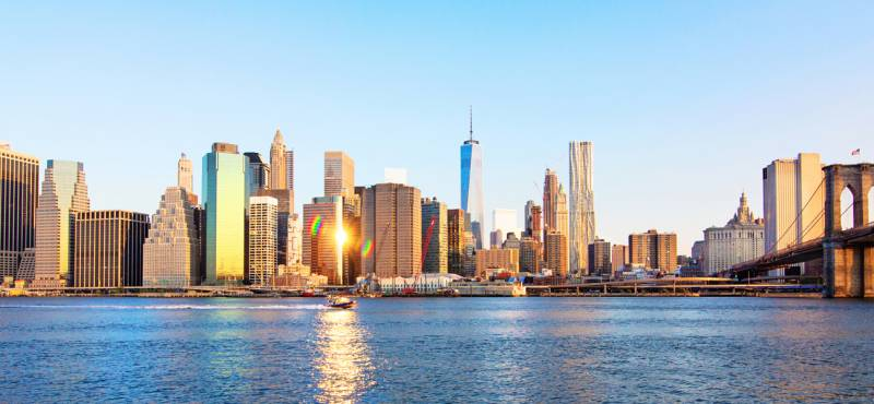 A panoramic view of the iconic Manhattan skyline on a bright sunny day in New York