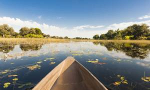 Okavango Delta and dugout canoe - Botswana best time to visit - On The Go Tours