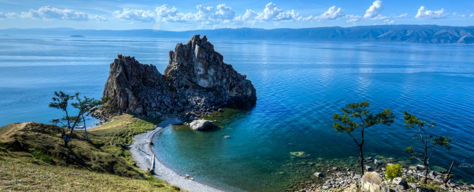 Shaman Rock, jutting out in to the sea off Olkhon Island