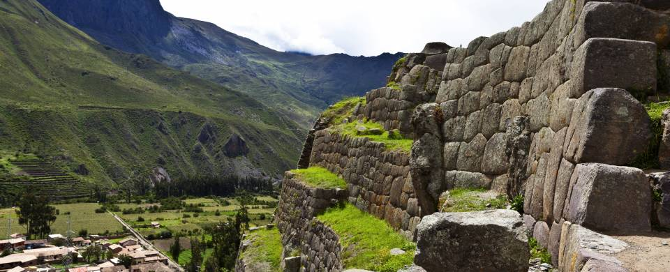 The ruins of Ollantaytambo nestled into the mountains of the Sacred Valley