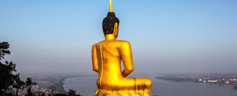 The golden Big Buddha Temple sitting atop a hill and looking out over the city of Pakse