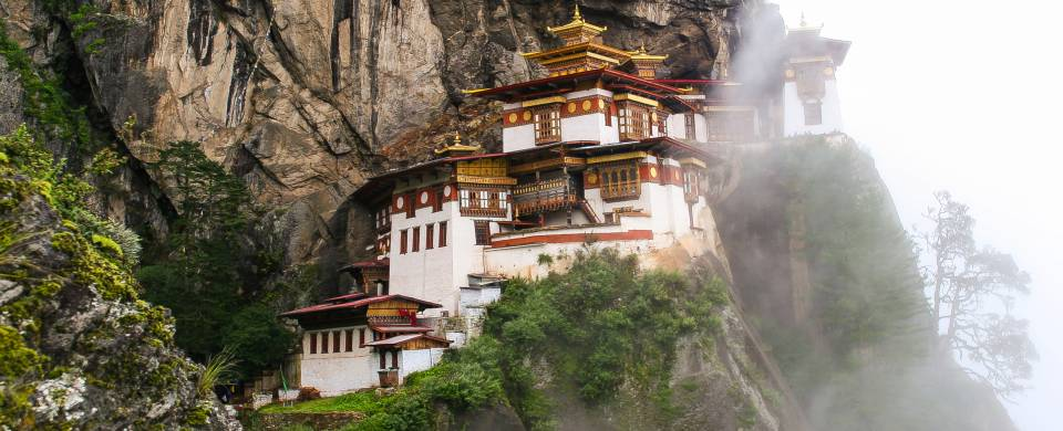 The Tiger Nest temple sitting precariously on the side of a cliff in Paro