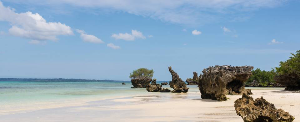 Big rocks on the white sandy beach of Pemba Island