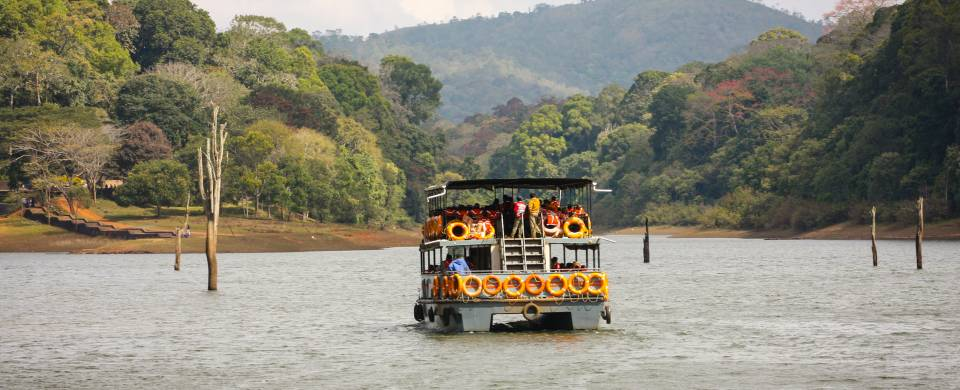 Boat along the water at the Periyar Wildlife Sanctuary