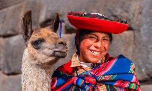 Peruvian lady and llama - Peru Tours - South America Tours - On The Go Tours