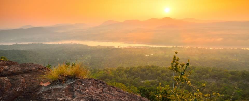 Stunning sunset painting the sky orange over Pha Taem National Park