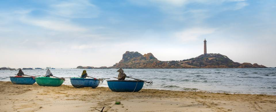 Boats along the edge of the water at the beach in Phan Thiet