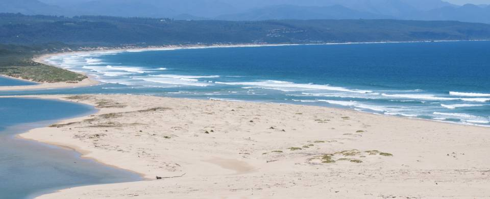 Dazzling blue lagoon and white sand in Plettenberg Bay