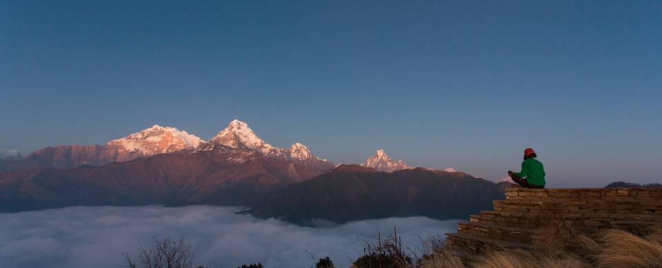 A trekker enjoys the incredible views of Poon Hill in Nepal's Annapurna region