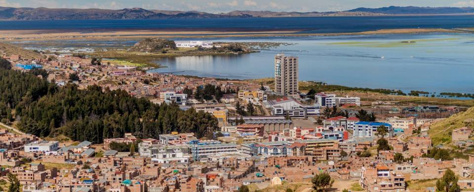 An aerial view of Puno city on the banks of Lake Titicaca in Peru