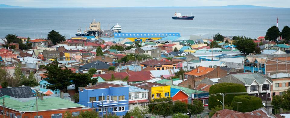 Scenic view of Punta Arenas - colourful houses and a boat in the background