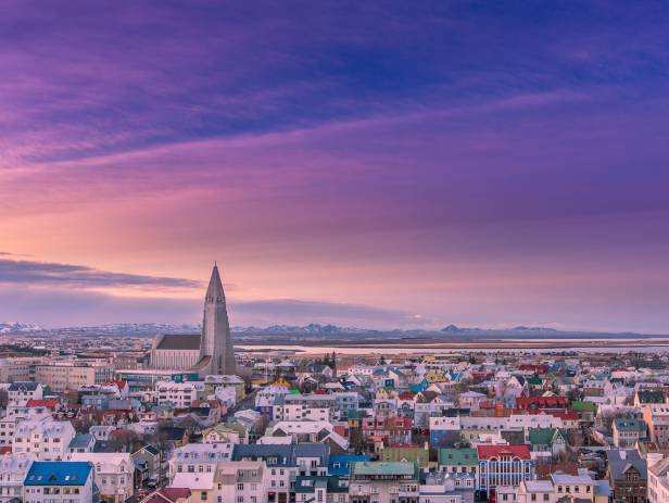 Colourful houses of Reykjavik against a backdrop of snowy mountains