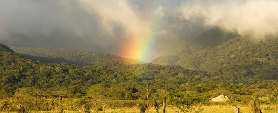 Rainbow touching the meadows surrounding the Rincon de la Vieja Volcano