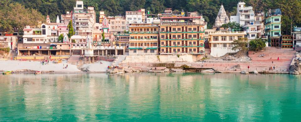 Colourful town of Rishikesh along the edge of the water