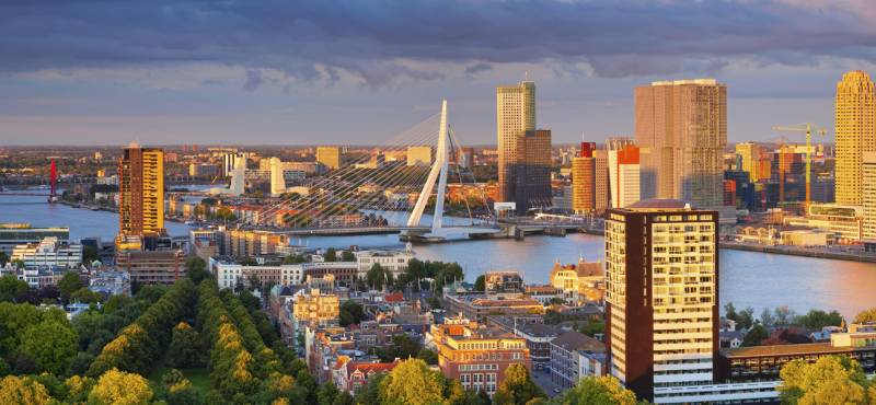 Panoramic image of Rotterdam, Netherlands during summer sunset
