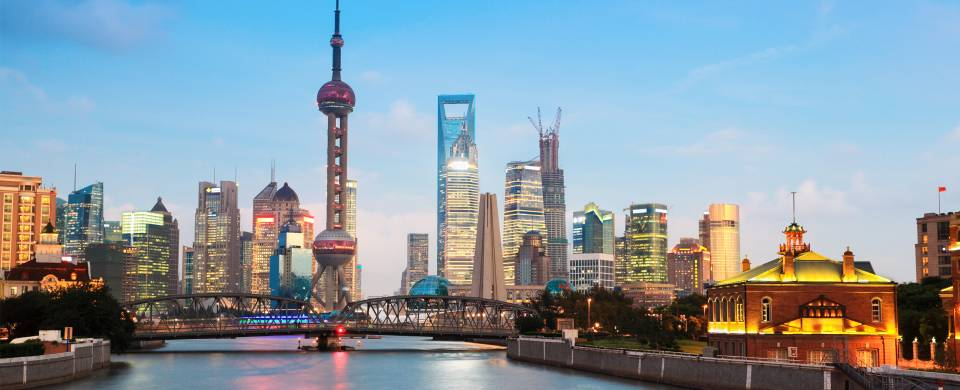 The view across the Huangpu River to the modern cityscape of Pudong in Shanghai